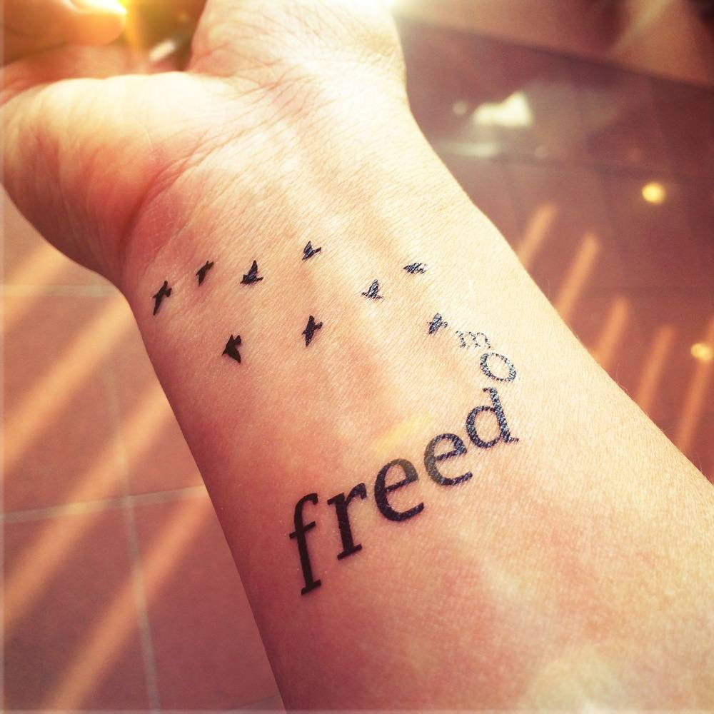 tattoo freedom writing decorated birds