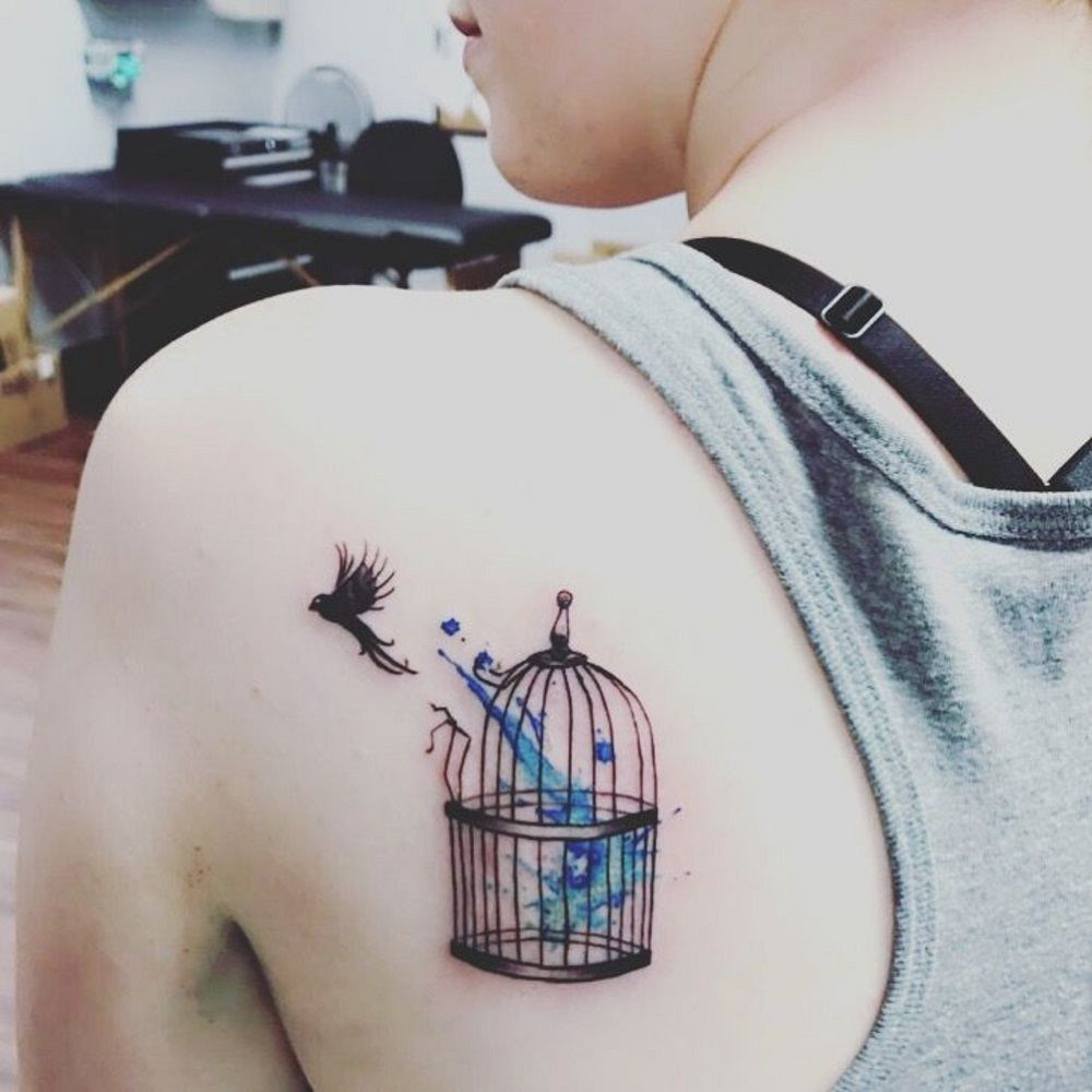 tattoo meaning freedom woman bird in flight cage