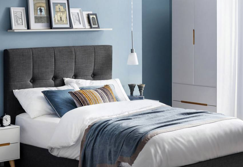Scandinavian single bedroom with blue accent